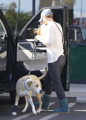 Kaley Cuoco with her dog out in LA