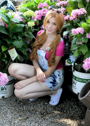 Katherine McNamara in Jeans Shorts at Garden Center in LA