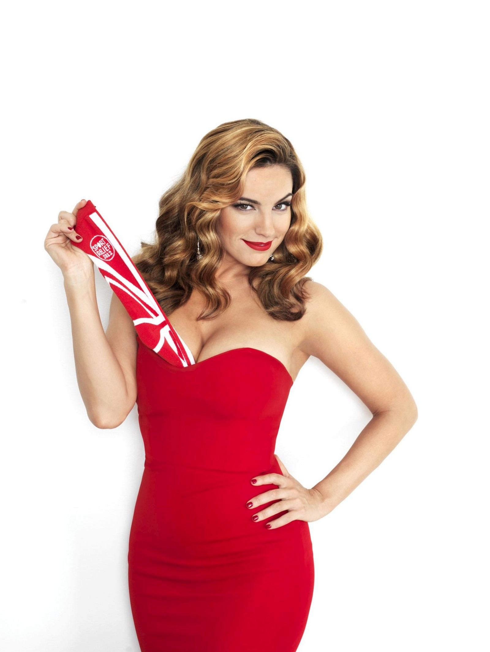 Kelly Brook 2012 : Kelly Brook Pulling socks from cleavage for Sports Relief 2012 charity photoshoot-03