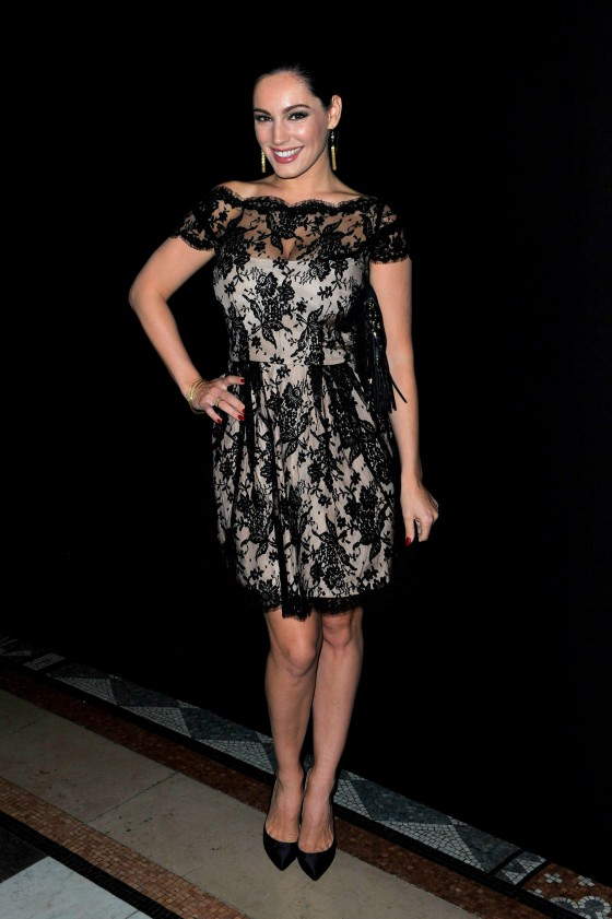 Kelly Brook ishowing legs at Philip Treacy fashion show