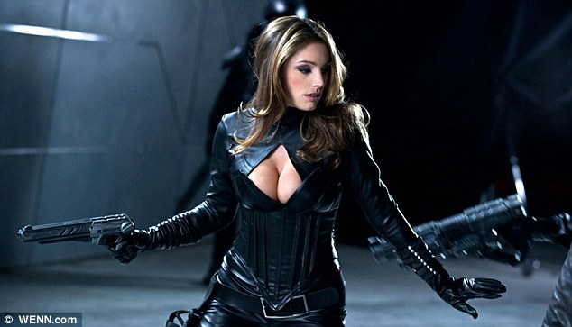 Kelly Brook cleavage in leather bodysuit-02