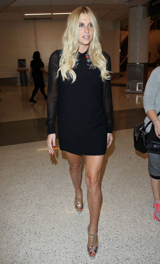 Kesha in Mini Dress Arrives at LAX Airport in Los Angeles