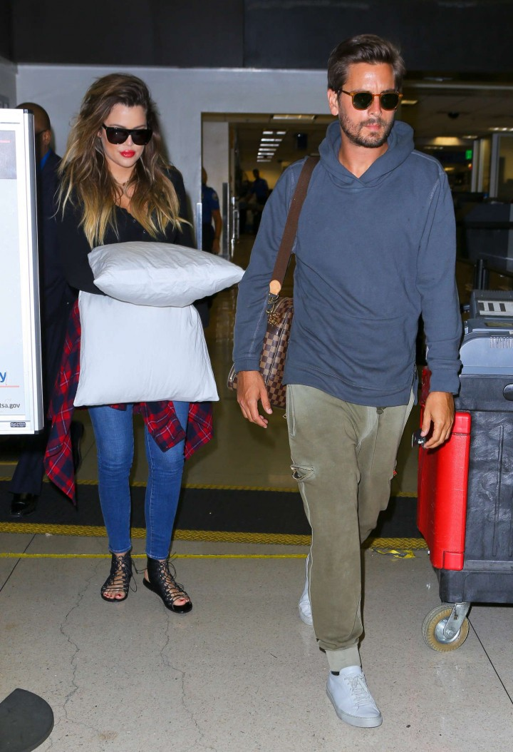 Khloe Kardashian with Scott Disick Arriving on a flight at LAX airport