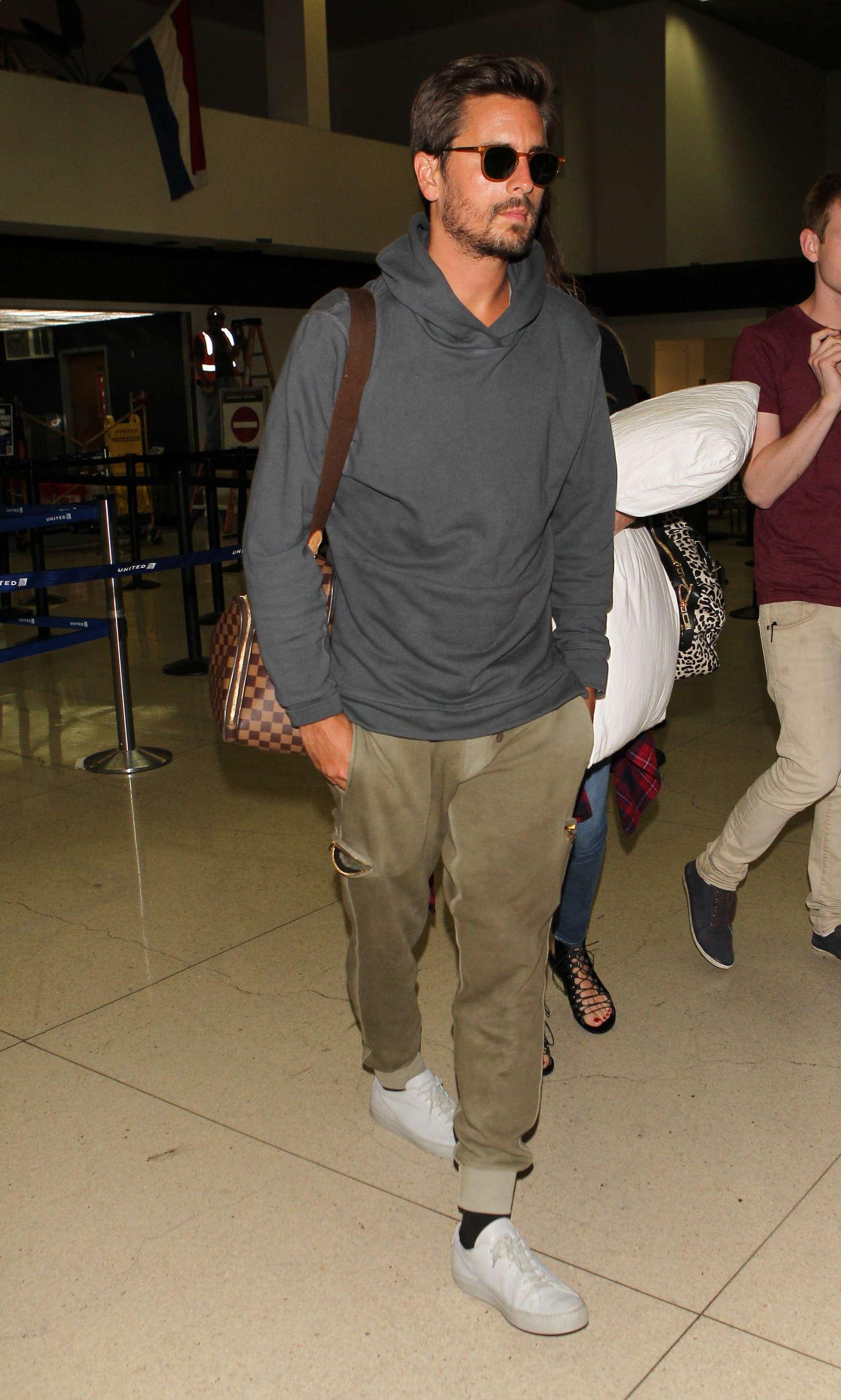 Khloe Kardashian 2014 : Khloe Kardashian with Scott Disick at LAX airport -07