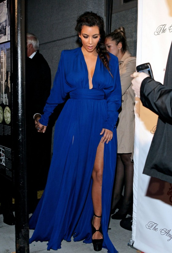 Kim Kardashian showing her legs and cleavage at 2012 Angel Ball in New York
