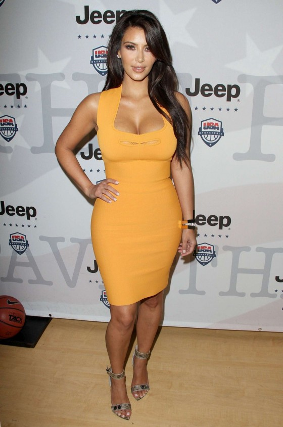 Kim Kardashian in a yellow tight dress at Power Foward Partnership Event