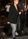 Kim Kardashian In Jeans Catching a Flight at MIA
