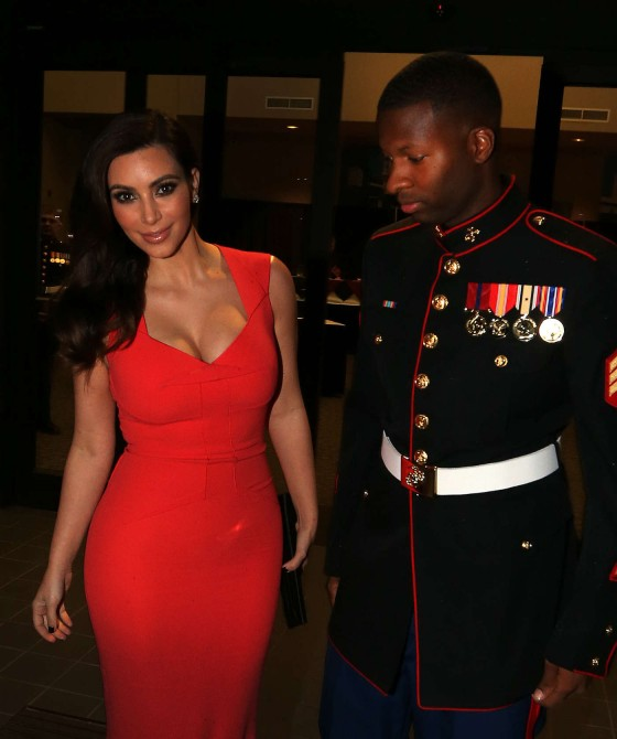Kim Kardashian - In red dress at HQ Battery 10th Marine Birthday Ball in North Carolina
