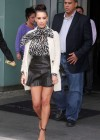 Kim Kardashian showing legs in a mini skirt at Milk Studios