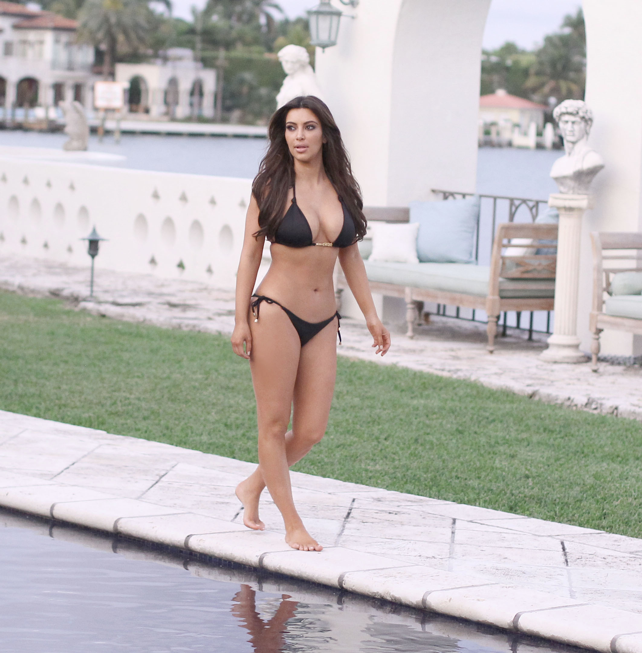 Kim Kardashian bikini at her friend Loren Ridingers mega mansion-13