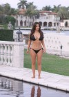 Kim Kardashian bikini at her friend Loren Ridingers mega mansion-17