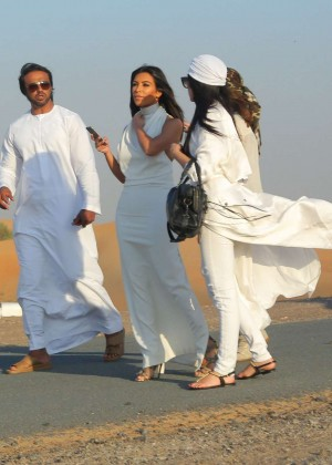 Kim Kardashian Walks The Desert in Dubai With Her Glam Squad