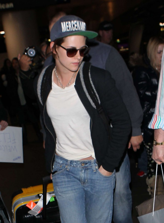 Kristen Stewart in Jeans and White T Shirt at LAX Airport in Los Angeles