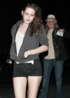 Kristen Stewart showing legs in Short Shorts at Florence and the Machine concert