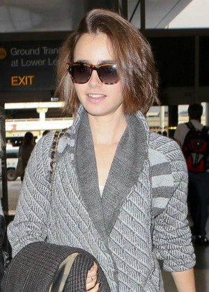 Lily Collins - Arrives at LAX in LA