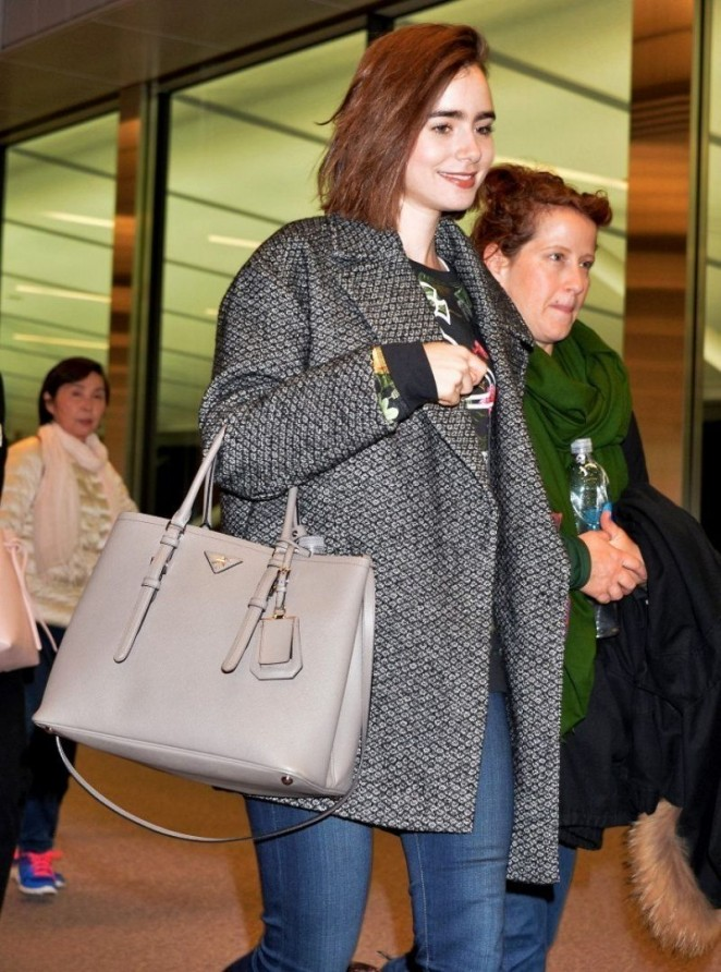 Lily Collins - Arrives at Narita International Airport in Tokyo
