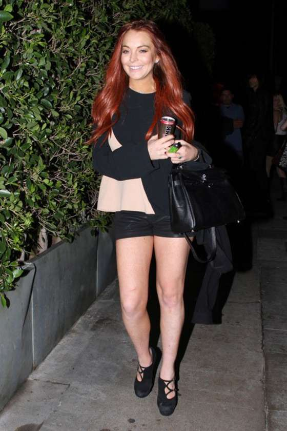 Lindsay Lohan Shows Legs While Leaving Giorgio Baldi restaurant in Santa Monica