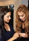 Lindsay Lohan Showing cleavage at Eva Fehren Jewelry Show