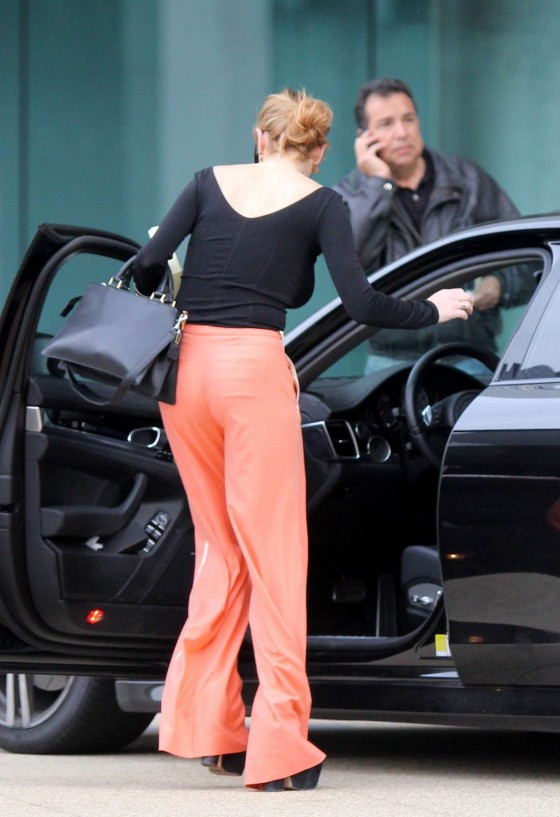 Lindsay Lohan Getting Into Her Porsche