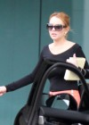 Lindsay Lohan Getting Into Her Porsche-22