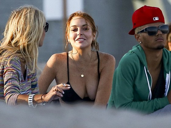Lindsay Lohan cleavage in a bikini top in California