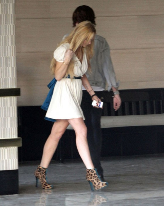 Lindsay Lohan leaving the London and show her sexy legs