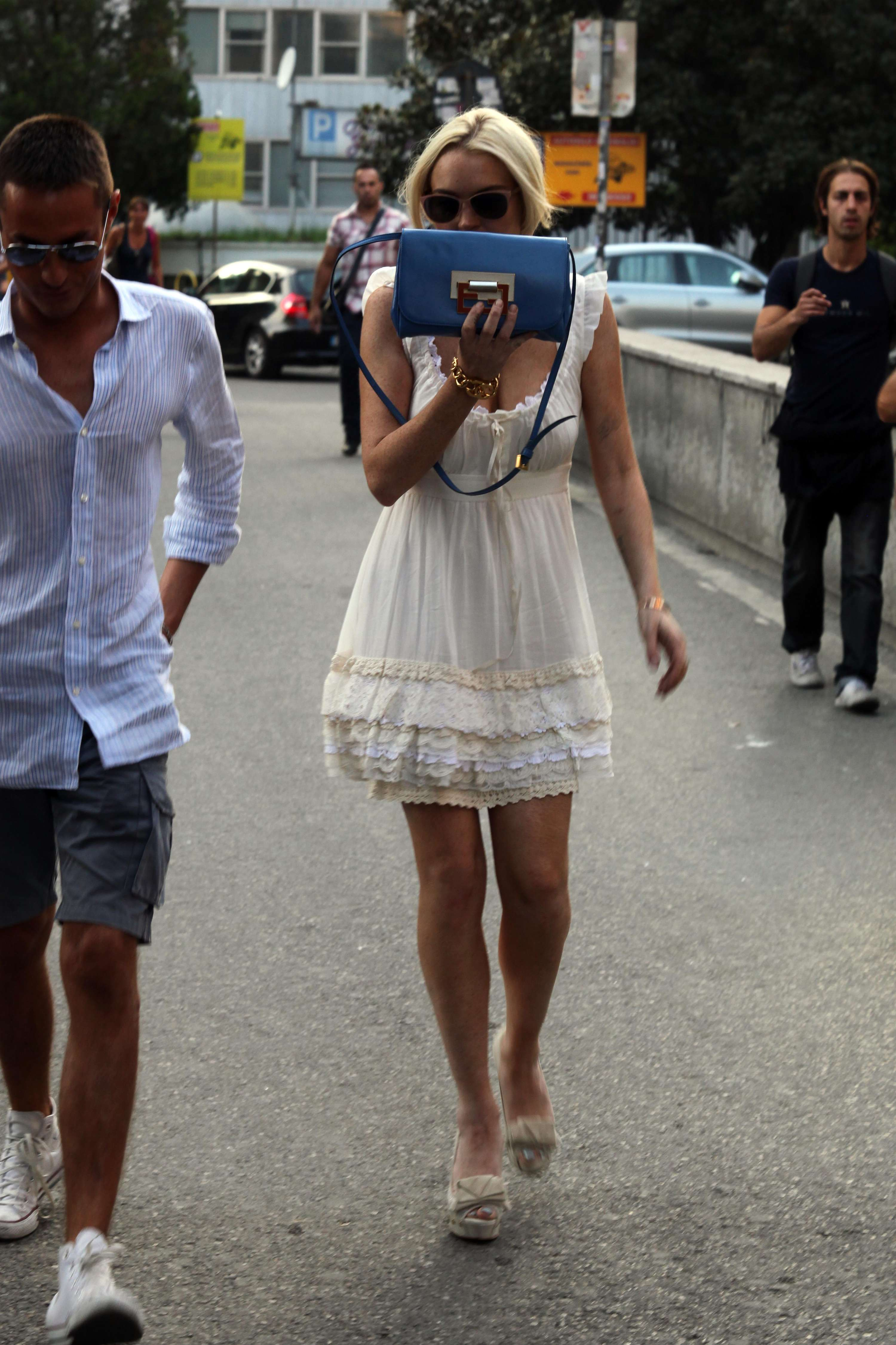 Lindsay Lohan - White Dress Candids in Italy-01 - GotCeleb