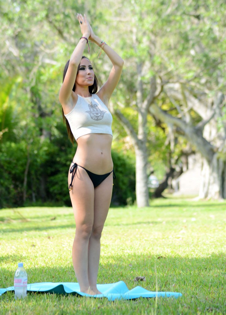 Lisa Opie doing yoga at a park in Miami