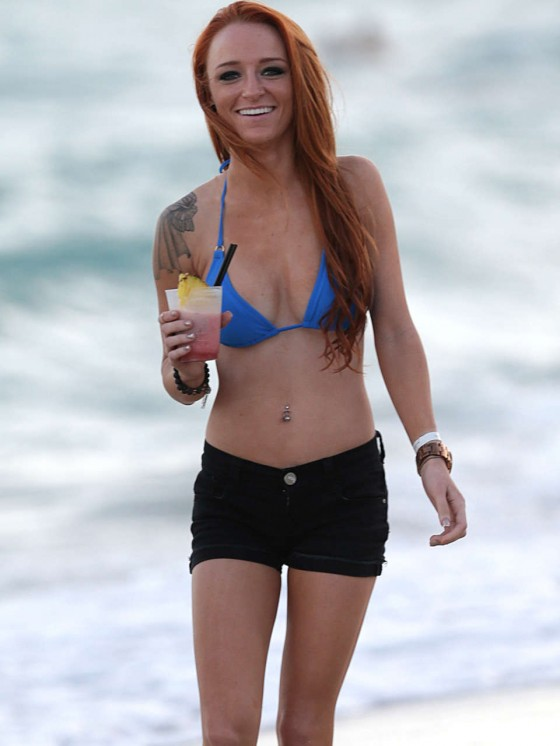 With her thin body and Light blond hairtype without bra (cup size 32B) on the beach in bikini