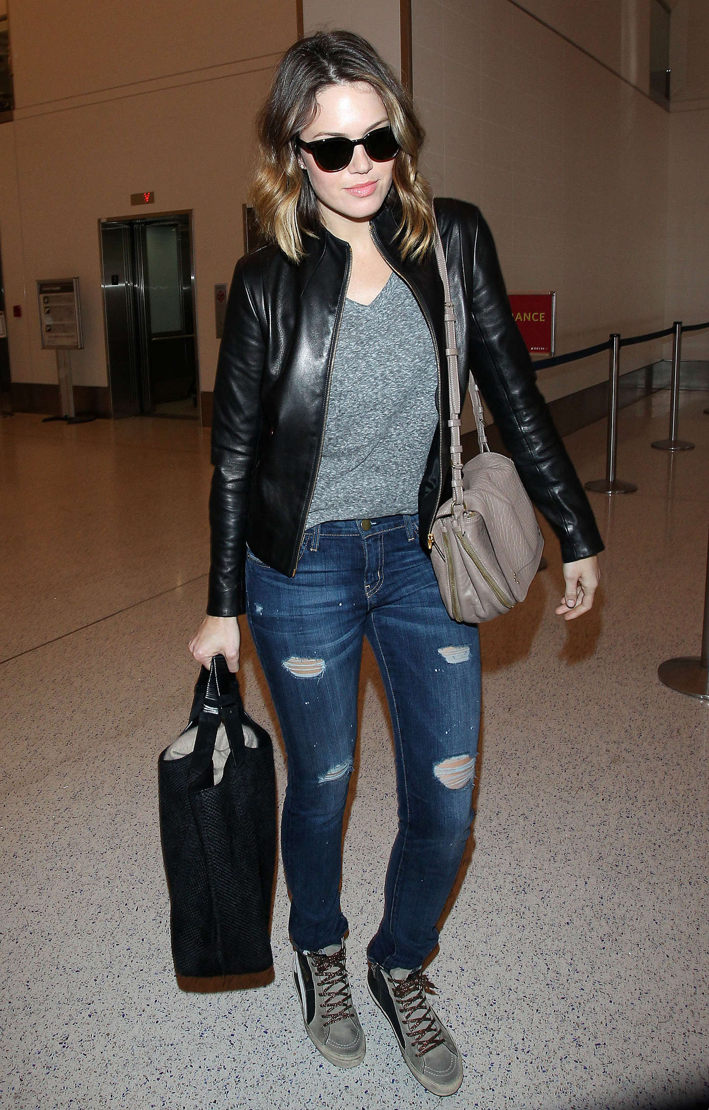Mandy Moore - In ripped jeans arriving at LAX Airport in Los Angeles