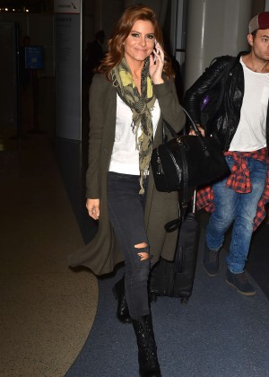 Maria Menounos in Ripped Jeans at LAX airport in LA
