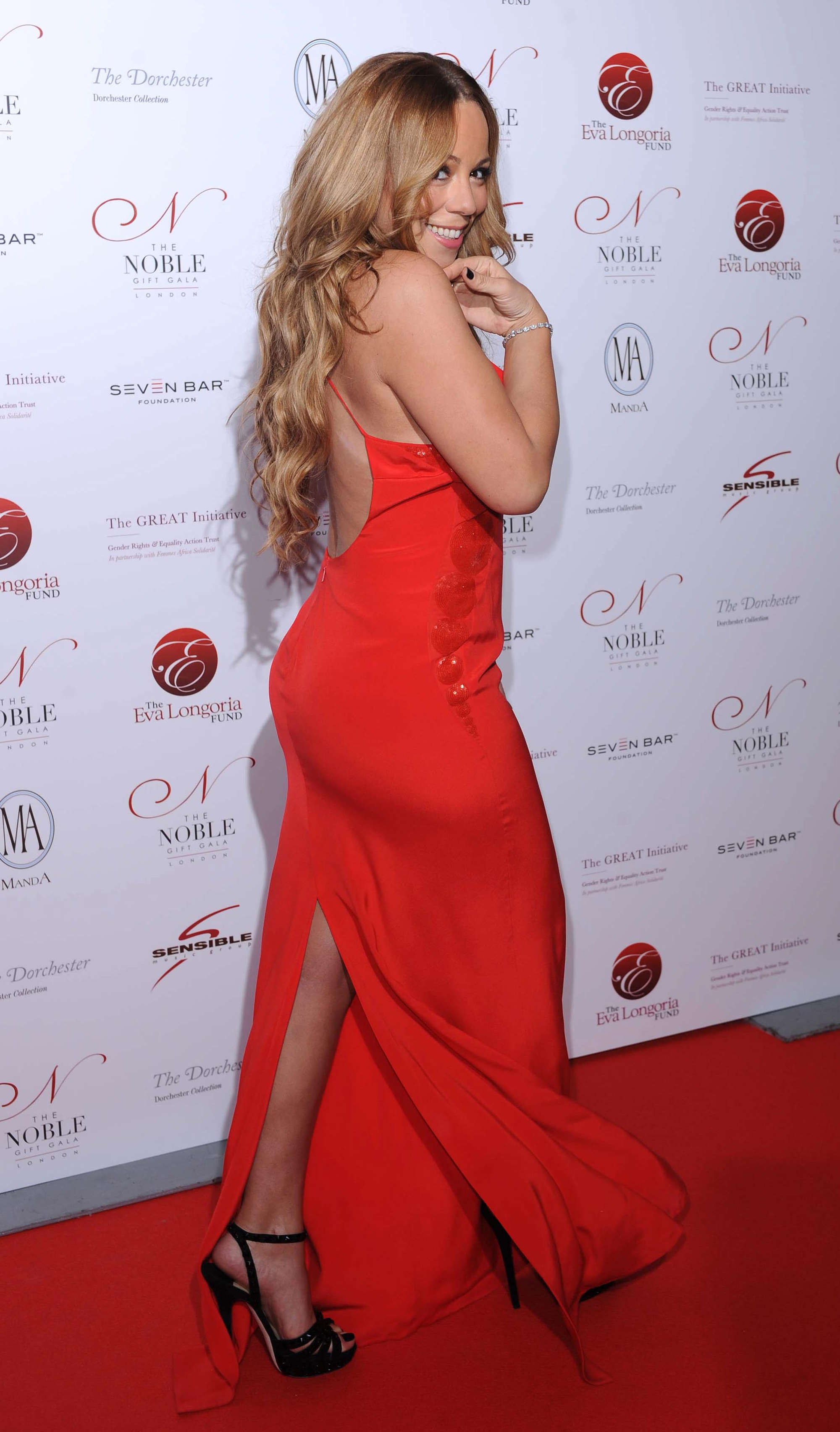 Mariah Carey Cleavage In Red Dress At Noble Gift Gala 05