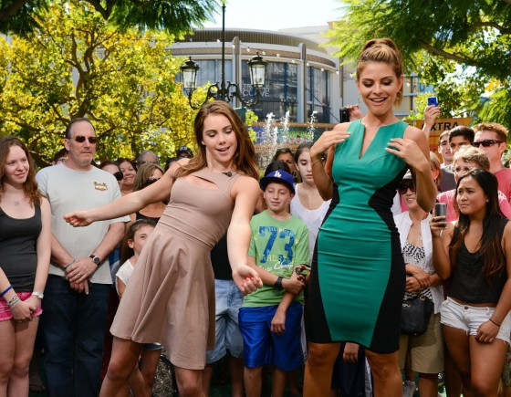 McKayla Maroney and Maria Menounos dance on the set of Extra at The Grove