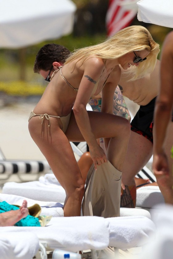 Michelle Hunziker wearing a gold bikini in Miami - April 2012