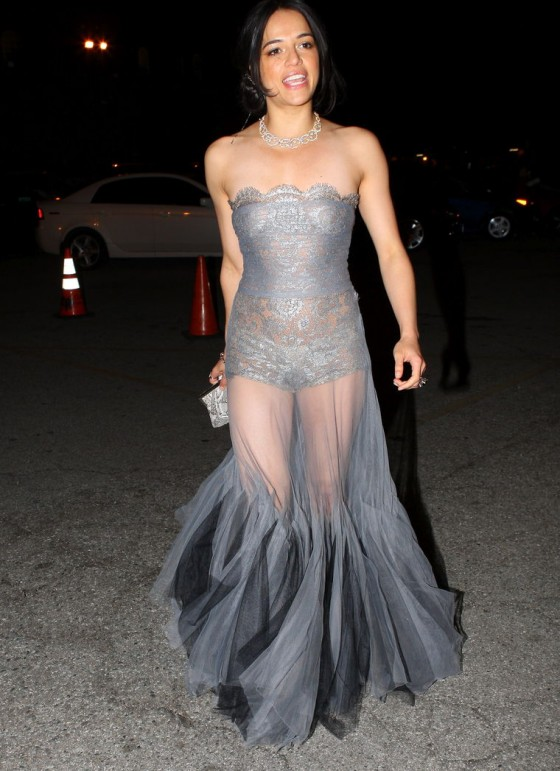 Michelle Rodriguez show her hot body in silver see-through dress.