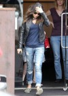 Mila Kunis in ripped jeans -01