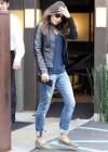 Mila Kunis in ripped jeans -02