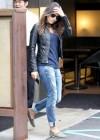 Mila Kunis in ripped jeans -03