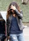 Mila Kunis in ripped jeans -06