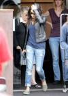 Mila Kunis in ripped jeans -08