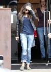 Mila Kunis in ripped jeans -09