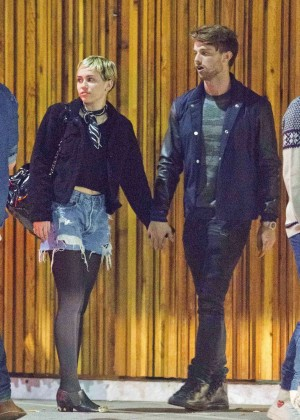 Miley Cyrus and Patrick Schwarzenegger - Holding Hands Outside Mr Nice Guy in West Hollywood