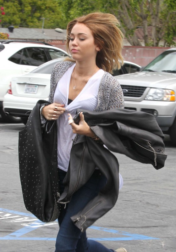 Miley Cyrus In white tshirt and skinny tight jeans at a Hospital in Los Angeles