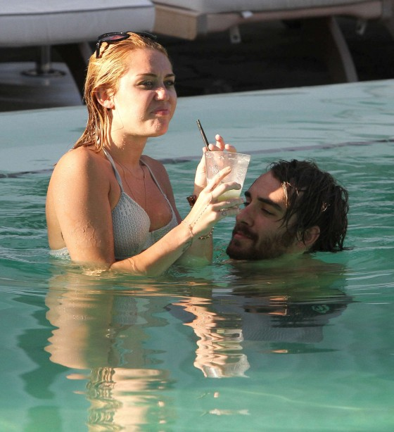 Miley Cyrus - Bikini at a Hotel Pool with Liam in Miami