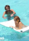 Miley Cyrus - Bikini - hotel pool in Miami-02