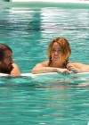 Miley Cyrus - Bikini - hotel pool in Miami-07
