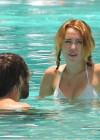 Miley Cyrus - Bikini - hotel pool in Miami-25