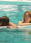 Miley Cyrus - Bikini - hotel pool in Miami-29