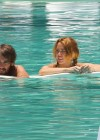 Miley Cyrus - Bikini - hotel pool in Miami-41