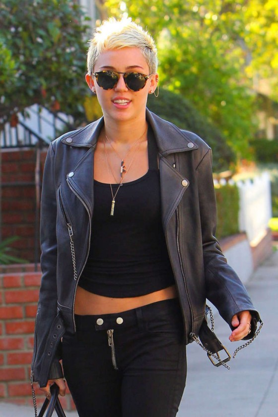 Miley Cyrus - In leather jacket and pants